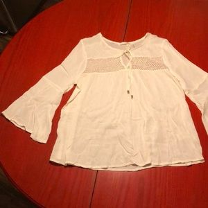 White bell sleeve top with lace and tie at neck